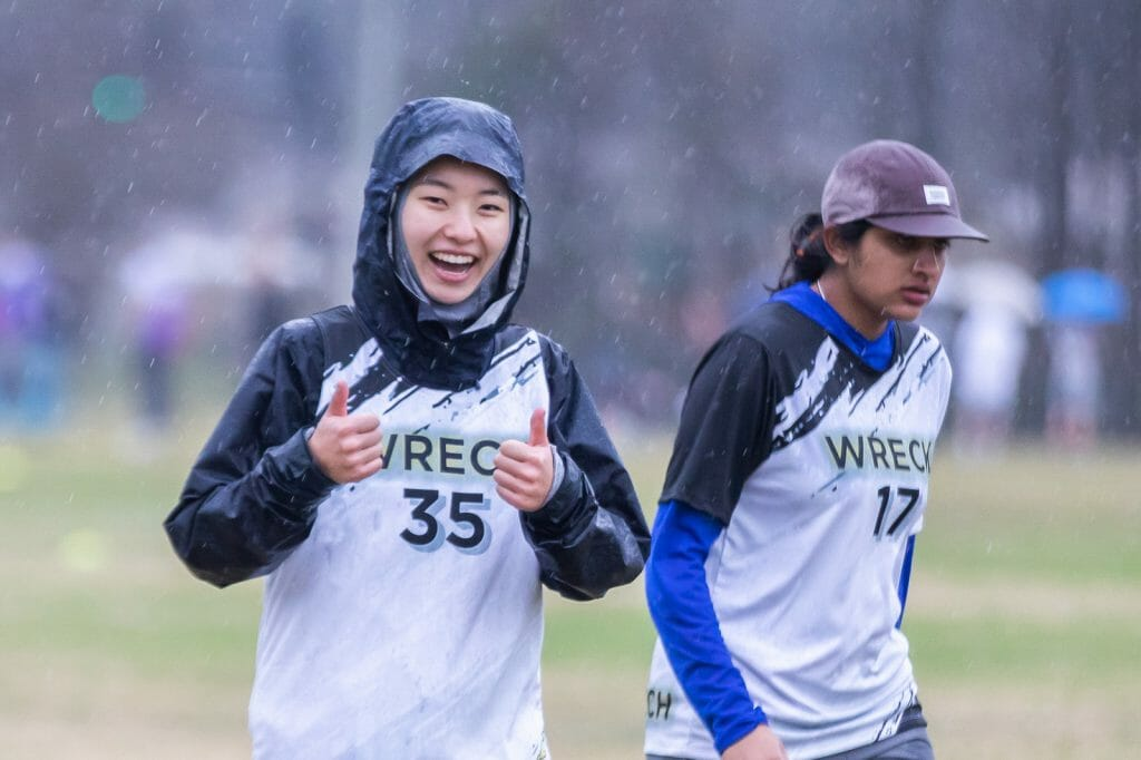 Georgia Tech Wreck college women's ultimate frisbee team players play through inclement weather. Photo: Katie Cooper -- UltiPhotos.com