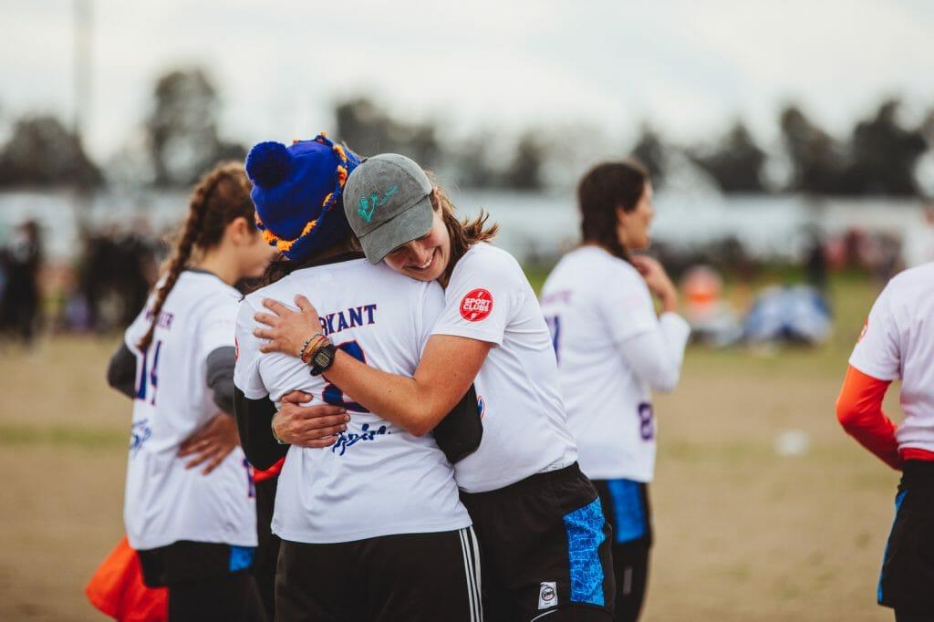 University of Florida college women's ultimate frisbee team members embrace. Photo: Natalie Bigman-Pimentel -- UltiPhotos.com