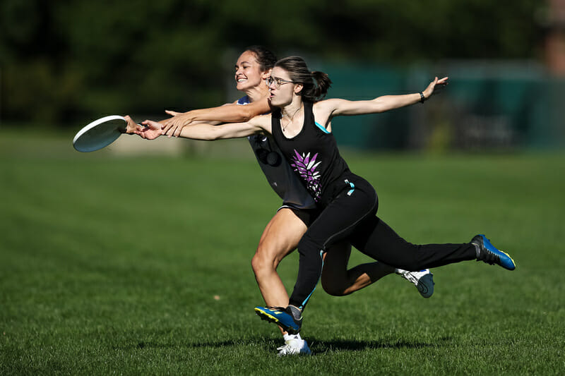 The disc is just an arm's length away for both players at 2021 East New England Women's Sectionals. Photo: Burt Granofsky — UltiPhotos.com